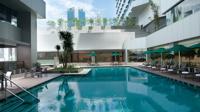 Kick back and bask in Malaysia's sunny climate by the salt water swimming pool.